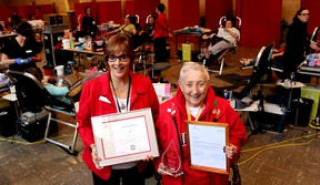 Cathy Schmidt (left) volunteer co-ordinator with Canadian Blood Services, presented Leona Bishop with three honours recognizing her 23 years as a dedicated volunteer with the blood collection agency on her last day as a volunteer at the blood donor clinic in Chatham.