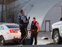 RCMP officers block access to Hampshire Road in Hinton on Oct. 5. (John Hopkins-Hill/ Hinton Parklander