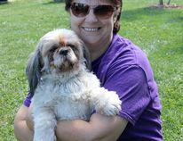 Nancy Ball, founder of CK Animal Rescue, is pictured in 2014 with her pet Shih Tzu Phoenix, who she rescued.