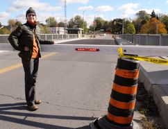 Traffic in and out of Port Dover Monday was complicated after safety barricades at the Highway 6 lift bridge locked in place and refused to rise. Checking out the situation is Maria Erdman of Port Dover. MONTE SONNENBERG / SIMCOE REFORMER