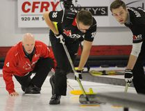 Glenn Howard, left, watches his sweepers work during Monday afternoon action at the Portage Curling Club. (Aaron Wilgosh/The Graphic)