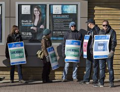Members of striking faculty at Conestoga College picket Monday outside the Odeon Building on Market Street in downtown Brantford. (Brian Thompson/The Expositor)