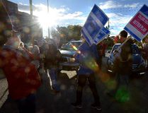 Members of the Fanshawe College faculty picket at the Oxford Street entrance to campus during the first day of their strike on Monday October 16, 2017. (MORRIS LAMONT, The London Free Press)
