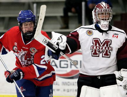 Chatham Maroons goalie Ryan Wagner hits Strathroy Rockets' Ty Glover in the third period at Chatham Memorial Arena on Sunday, Oct. 15, 2017. (MARK MALONE/The Daily News)