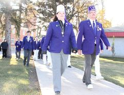 Grand Exalted Ruler Debbie Sallenback and Sask. Elks President Kalvin Nankivell approach the cenotaph at Memorial Garden during the opening ceremony for the Elks Walk-a-Thon on Saturday, October 14.