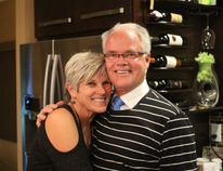 Photo by Keenan Sorokan Reporter/Examiner - Stuart Houston poses with his wife Debra at their home following the news of Houston's victory over Dan Doornekamp for mayor of Spruce Grove.