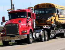 Chatham-Kent police report a 78-year-old Wallaceburg, Ont. woman suffered serious, but non-life threatening injuries after her vehicle collided with this school bus, being shown towed from the scene at Croton Line and Dawn Mills Road, east of Dresden, Ont. on Tuesday October 17, 2017. Police said some of the passengers reported minor injuries as result of the collision, but no medical assistance was required. The collision remains under investigation. (Ellwood Shreve/Chatham Daily News)