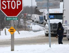 Traffic backs up at the intersection of County Roads 2 and 3 as as result of a massive Highway 401 collision in this March 15, 2017 file photo. (FILE PHOTO)