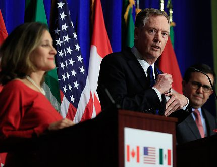 United States Trade Representative Robert Lighthizer, centre, with Canadian Minister of Foreign Affairs Chrystia Freeland, left, and Mexico's Secretary of Economy Ildefonso Guajardo Villarrea, right, speaks during the conclusion of the fourth round of negotiations for a new North American Free Trade Agreement (NAFTA) in Washington, Tuesday, Oct. 17, 2017. (AP Photo/Manuel Balce Ceneta)