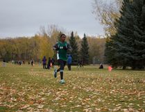 Old Scona Academic Grade 10 student Bill Makwae wins the junior boys' Edmonton Zone cross-country title last Wednesday at Rundle Park. Photo by Madeleine Cummings.