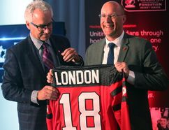 Tom Renney of Hockey Canada hands London Mayor Matt Brown a jersey after it was announced that the Hockey Canada Foundation gala and golf event will be held in London next summer. Photograph taken on Tuesday October 17, 2017. (MIKE HENSEN, The London Free Press)