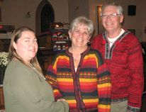 Mary Simmons, president of Maitland Presbyterial is seen welcoming Deb and Bob Loree of Listowel to the Fall Rally.