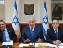 Israeli Prime Minister Benjamin Netanyahu, center, attend the weekly cabinet meeting at the prime minister's office in Jerusalem, Sunday, Oct. 15, 2017. (Abir Sultan/Pool Photo via AP)