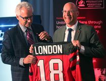Tom Renney of Hockey Canada hands London mayor Matt Brown a jersey after it was announced that the Hockey Canada Foundation gala will be held in London next summer.