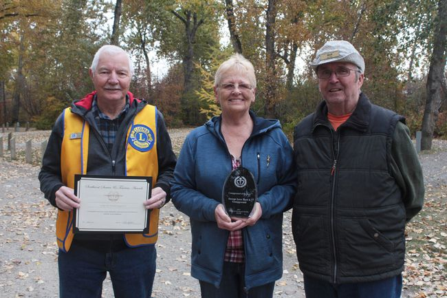 KEVIN RUSHWORTH HIGH RIVER TIMES/POSTMEDIA NETWORK. The George Lane Memorial Park campground received campground of the year award from the 2017 Southwest Service and Tourism Awards. From left to right are Tom Carson, Darlene Wilms and Wolf Wilms.