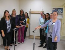 Cold Lake Healthcare Centre staff pose with the new parallel bars in the rehabilitation department. Left, back to front: Lesley Vivian, physiotherapist; Jennifer Skiba, therapy assistant, Sharon Winik, Allied Health area manager and Theresa Nickel, Executive Director of the Hearts for Healthcare Foundation. Right, back to front: Todd Farrell, occupational therapy clinical lead, Raelynn Fehr, therapy assistant; Meg O'Brien, physiotherapist; Nichole Lang, therapy assistant and Charmaine Cantwell, occupational therapist.