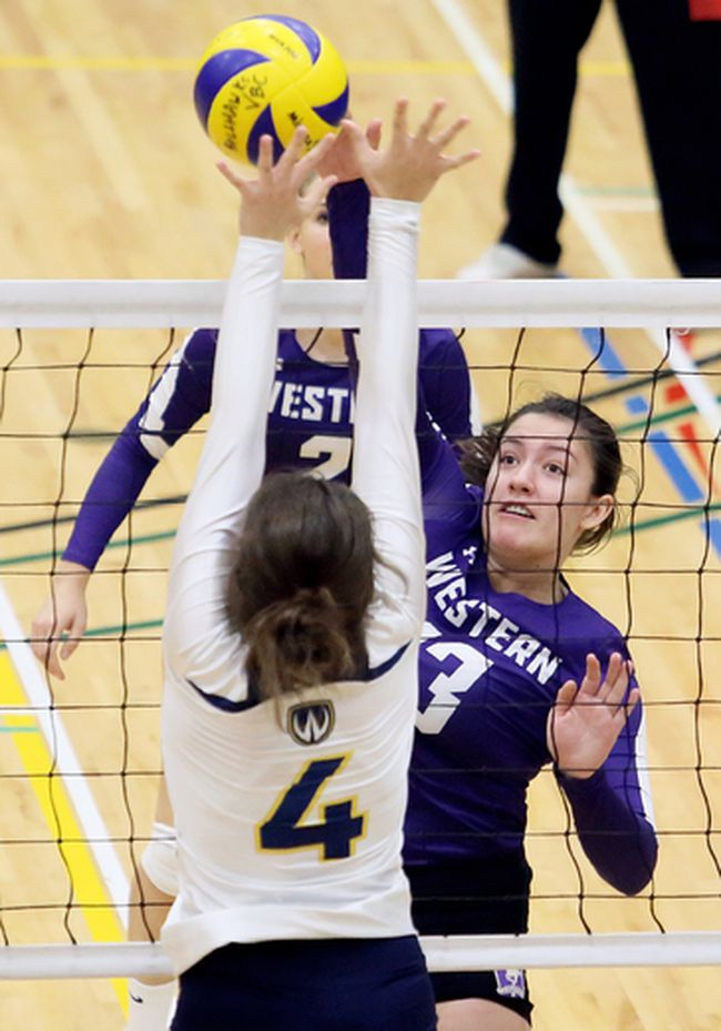 Western Mustangs' Katie McKenna (13) hits against Windsor Lancers' Brooke Davis (4) during an exhibition volleyball match at St. Clair College's Thames Campus HealthPlex in Chatham, Ont., on Tuesday, Oct. 17, 2017. Mark Malone/Chatham Daily News/Postmedia Network