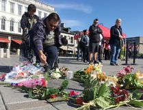 Elliot Ferguson/The Whig-Standard William Nakogee from the Kashechewan First Nation sprinkles tobacco in Springer Market Square to honour The Tragically Hip lead signer Gord Downie on Wednesday.