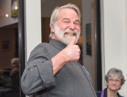 Mayor John Borrowman gives a thumbs up as he learns he has won the vote for Canmore Mayor at a gathering of supporters at the Hive Gallery on Main Street on Monday. To his left is his daughter Katie Borrowman and at the right are a woman supporter, his wife Lynn and Bert Dyck who offers to shake his hand. photo by Pam Doyle/www.pamdoylephoto.com