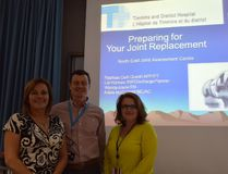 The Timmins and District Hospital's joint assessment centre has helped reduce wait times for joint surgery. On Wednesday, staff prepared to offer a talk on preparing for joint replacement. From left are secretary Adele McConnell, social work discharge planner Lia Holmes and advanced practice physiotherapist Raphael Delli Quadri.