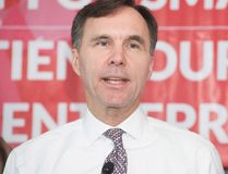 Minister of Finance Bill Morneau speaks to local business owners and media during a press conference at Station 33 Cafe & Yoga in Hampton, N.B., on Wednesday, Oct. 18, 2017. (Stephen MacGillivray/The Canadian Press)