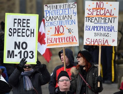 Protesters rally over motion M-103, the Liberal anti-Islamophobia motion, on Parliament Hill in Ottawa on March 21, 2017. (Sean Kilpatrick/The Canadian Press)