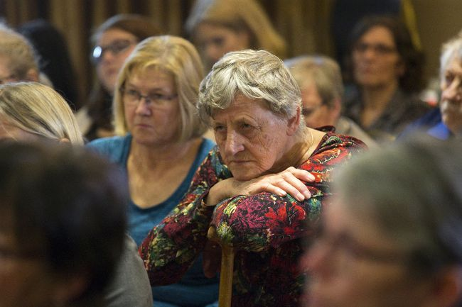 Nelda DeJong listens as the public inquiry into the crimes of nursing home serial killer Elizabeth Wettlaufer held its first public meeting in Woodstock Wednesday. Though not a victim, her mother was a resident at Woodstock's  Caressant Care home when Wettlaufer worked there. (DEREK RUTTAN, The London Free Press)