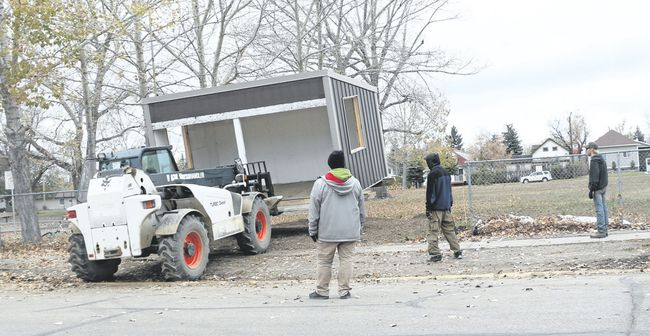 PLRD installed a new bus shelter on Thursday at the old Hanna Primary school site to provide a buffer against the elements for the more than 50 students that wait for the bus there on school mornings. The shelter is not fully complete as it will have windows on the east and west sides to add a further layer of protection. Jackie Irwin/ Hanna Herald