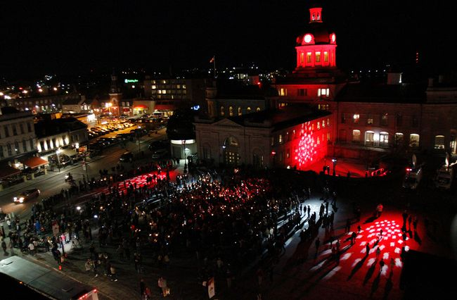 The community came together to celebrate and honour the life of Gord Downie with an impromptu candlelight vigil in Springer Market Square in Kingston on Wednesday night. (Julia McKay/The Whig-Standard)