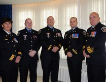 Members of Wood Buffalo's Regional Emergency Services pose for a group photo after receiving the Sovereign's Medal for Volunteers at a ceremony in Edmonton, Alta. on Tuesday, October 17, 2017. L-R: Dana Allen, Scott Germain, Pat Duggan, Ryan Pitchers and Brad Grainger. Supplied Image/Office of the Lieutenant Governor of Alberta