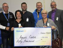 <p>Walmart's Harmony Distribution Centre celebrated its grand opening in a big way on Thursday October 19, 2017 in Cornwall, Ont. The company donated $50,000 to the Agape Centre on behalf of its employees. Shown here are senior director of logistics Drew Robertson, Agape's executive director Dianne Plourde, Agape board member Gabriel Riviere-Reid, senior vice-president of logistics John Bayliss, Agape board members Johanne Couture and Marc Lecuyer.</p><p> Lois Ann Baker/Cornwall Standard-Freeholder/Postmedia Network