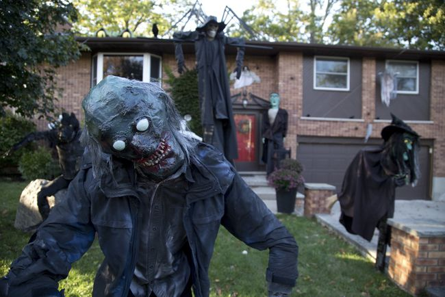 Damien Gallagher's London home at 101 Dearborn Ave. comes alive with ghoulish characters he's been creating for 17 years to celebrate Halloween. (DEREK RUTTAN, The London Free Press)