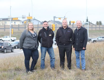 City councillors Candice Kolson, left, Fred Burley, middle left, Mayor Peter Brown, middle right and Bob Neale, manager of capital projects and infrastructure for the City of Airdrie stand in front of the newly improved Sierra Springs Dr. - Yankee Valley Blvd. intersection on Friday, Oct. 13, 2017.