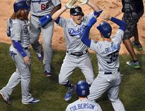 Dodgers' Enrique Hernandez (centre) celebrates his grand slam during the third inning against the Cubs in Game 5 of the NL Championship Series at Wrigley Field in Chicago on Thursday, Oct. 19, 2017. (John Starks/Daily Herald via AP)