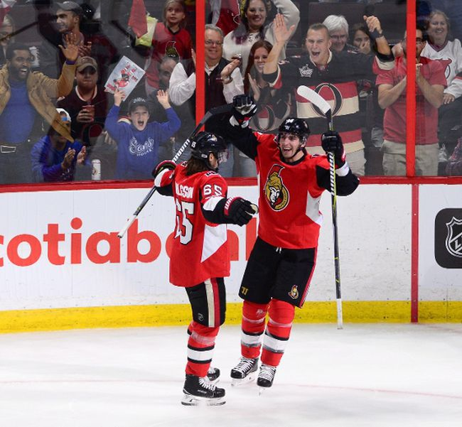 Ottawa Senators right winger Alexandre Burrows (right) celebrates a goal with teammate Erik Karlsson on Oct. 19, 2017. (SEAN KILPATRICK/The Canadian Press)