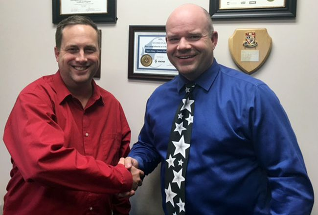Central Manitoba Tourism chair Tyler King, left, welcomes Vern May, chair of the Island on the Prairies tourism initiative, to the CBT family earlier this week in Portage la Prairie. (Submitted)