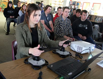Beaver Brae Secondary School trades student Delaney Peters, 16, learned how to work construction on a simulator, nicknamed Baby Betsy, during the day-long presentation students received on careers in the industry from the Ontario Construction Careers Alliance. SHERI LAMB/Daily Miner and News/Postmedia Network