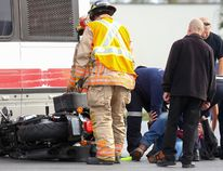 Paramedics check on a rider while firefighters examine his motorcycle following a collision between the bike and a city bus on Sunday October 22, 2017 in Belleville, Ont. The collision occurred shortly after 3 p.m. at the corner of Dundas Street East and Haig Road. Tim Miller/Belleville Intelligencer/Postmedia Network