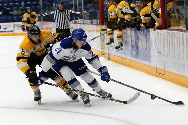 Greater Kingston minor hockey grad Nolan Hutcheson, right, of the Sudbury Wolves attempts to skate around Kingston Frontenacs defenceman Jacob Paquette during OHL action at the Sudbury Community Centre on Saturday night. The Wolves won 3-2. (John Lappa/Postmedia Network)