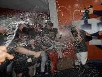 Houston Astros' Jose Altuve is sprayed with champagne