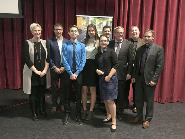 Minister of Education David Eggen, pictured far right, along with the Inclusivity Project Judges pose with winners Jack Adams, third from the left, Alia Nielsen, fourth from the left and Serena Michie, front row. The group have the option of travelling for two weeks to Abu Dhabi or taking the money for a scholarship after presenting their project, Bocce Ball for All to the community on Oct. 23.