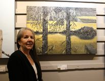 """Johanne Levesque stands before her acrylic painting """"Epinettes Noires"""" which took the NOAA award during the 61st annual Juried Exhibition."""