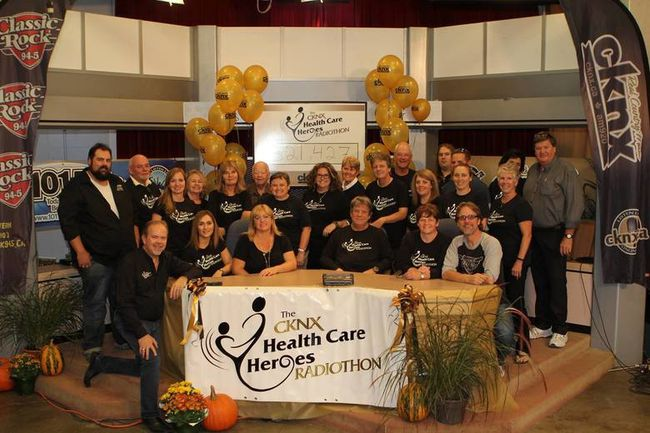 The eight participating hospital foundations, hosts, and volunteers with the grand total - $321,427.