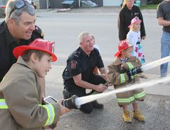 Fire Prevention Week brought a chance for children to participate at the Ripley Fire Department Open House on Oct. 10, 2017. Fire related exercises were available for families to experience while learning ways to prevent fires and what to do if a fire situation arises at your home. Pictured: Ripley Fire Department staff help kids have a turn at the fire hose during the Ripley Fire Department Open House. Future firefighters Joe Simick and Dylan Wall try their hand with the fire hoses.