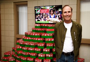 Volunteer Darryl Dennis stands beside a stack of shoeboxes at Temple Baptist Church, full of presents heading towards children living in impoverished and war-torn countries around the world. The shoeboxes are part of Samaritan's Purse's annual Operation Christmas Child campaign, held since 1993. Handout/Sarnia This Week