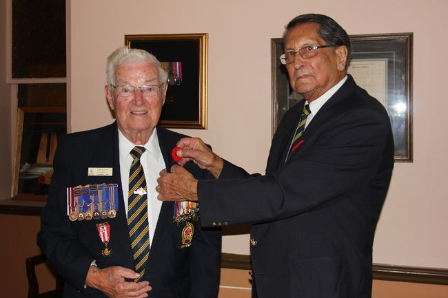 <p>Clifford Merpaw pins a poppy on Second World War veteran Ernie Pain on Monday October 23, 2017 in Cornwall, Ont. The Royal Canadian Legion launches its annual poppy campaign on Oct. 27.</p><p>