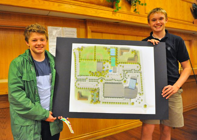 Norfolk Hammerheads Aquatic Club members Sean Anderson of Walsingham and Port Dover's Oliver Godelie hold a conception drawing of what a proposed recreation hub in Simcoe might look like. The two were part of a crowd that attended Monday's public consultation regarding the facility at the Port Rowan Community Centre. JACOB ROBINSON/Simcoe Reformer