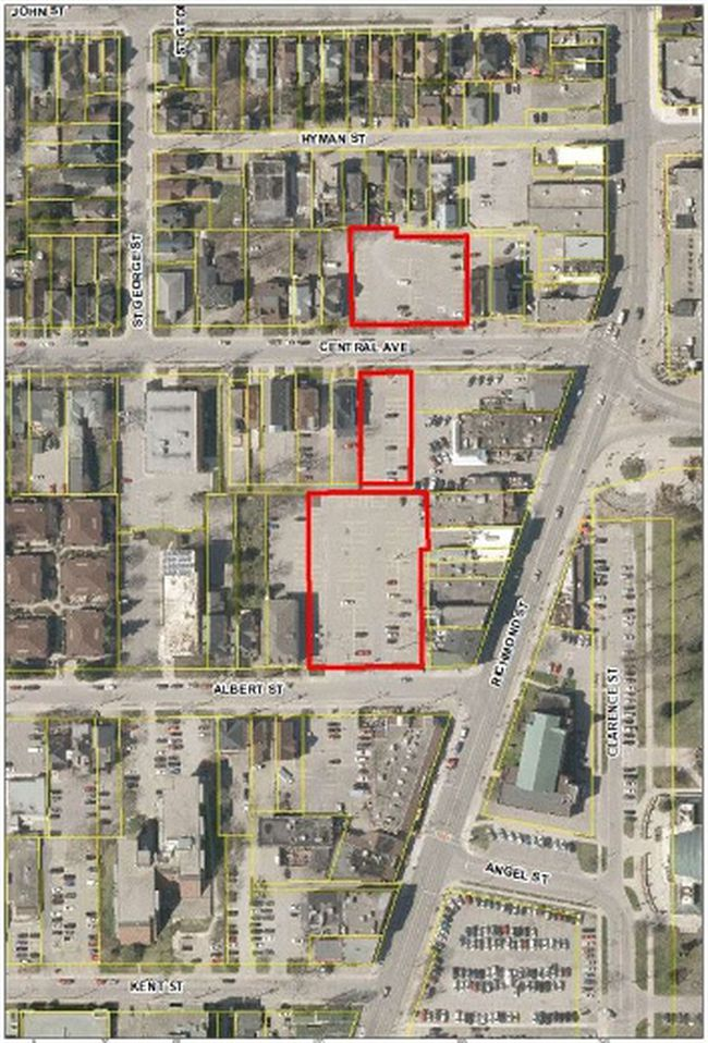 The city is studying whether to end parking on one of these three lots west of Richmond Row between ­Albert Street and Central Avenue.