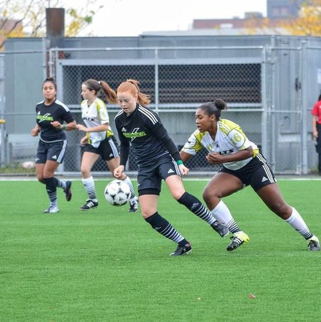 <p>Cornwall's Melissa Gilligan (closest to ball), seen in OCAA regular season action in this Ellen Bond photo, is in Sudbury with her Algonquin Thunder teammates, looking for a provincial soccer crown. </p><p>