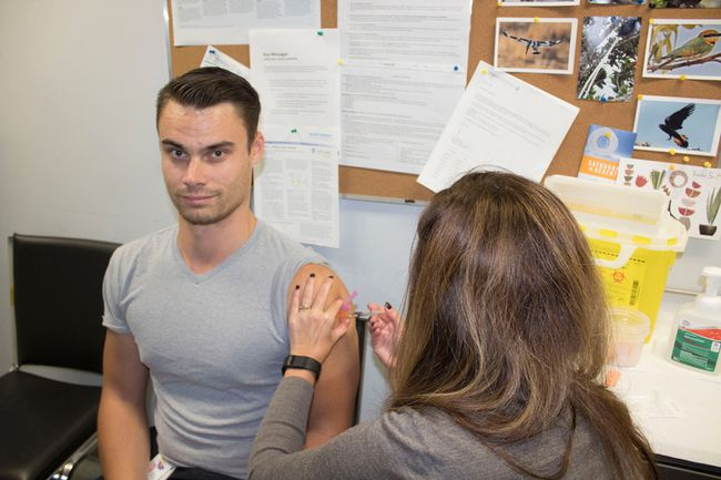 Tyson Benn, 27, who is on a social work student placement at Brantford General Hospital, gets a flu shot. He said he believes in getting the shot to help protect his co-workers and patients. (Submitted Photo)